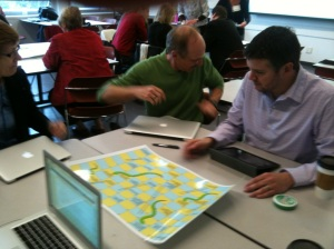 Participants playing a learning analytics game of snakes and ladders